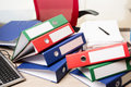 The stacks of office binders on desk Royalty Free Stock Photo