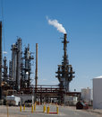 Stacks of an oil refinery processing crude oil Stock Images