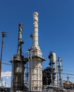 Stacks of an oil refinery processing crude oil Stock Photography