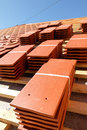 Stacks of roof tiles a under construction with Stock Photo