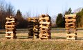Stacks of seasoned firewood neatly stacked piles for sale along side the local highway Stock Photography