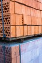 Stacks of silicate bricks on wooden pallets and in polyethylene Royalty Free Stock Image