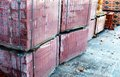 Stacks of silicate bricks on wooden pallets and in polyethylene Stock Photo