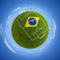 Stadium with brazil flag round soccer in the middle Stock Images