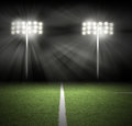 Stadium game night lights on black two football are shinning a green grass field for a sport concept Royalty Free Stock Photography
