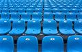 Stadium grandstand empty plastic chairs of blue color on grandstands Royalty Free Stock Photo