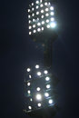 Stadium lights against dark night sky background Royalty Free Stock Images