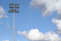 Stadium lights on a blue sky background with clouds Stock Photos
