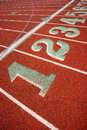 Stadium running track lane markers sports field number markings the up close at school Royalty Free Stock Photography