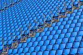Stadium seating with blue folded up chairs Royalty Free Stock Photo