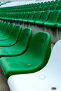 Stadium seats rows of green white plastic in empty Stock Photos