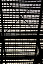 Stadium silhouetted supports and lightly streaked windows Royalty Free Stock Photos