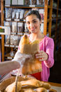 Staff giving packet bread to woman Royalty Free Stock Photo