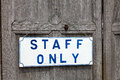 Staff only notice hanging on an old wooden door Royalty Free Stock Image