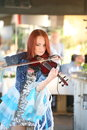 On stage beautiful frail and slender girl with fiery red hair a well known musician virtuoso violinist maria bessonova enchanting Royalty Free Stock Photos