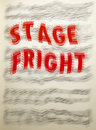 Stage fright blurred musical notes behind large red text Royalty Free Stock Photos