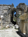 Stage of the greco roman theater in turkey with lycian tombs adjacent to these landmarks were built at different times but look Stock Photo