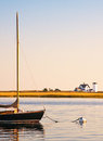 Stage harbor Lighthouse and Sailboat Stock Photo