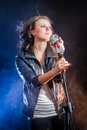 Stage lighting and fog with young singer Stock Images