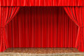 Stage with open red curtain Royalty Free Stock Photography