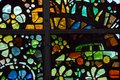 Stain glass car detail of a colorful window depicting flowers and a Stock Photography