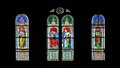 Stain glass window with jesus in an old church black background Stock Image