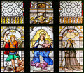 Stained Glass - Archangel Michael, Madonna and Child and Saint T Royalty Free Stock Photo