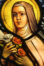 Stained glass beautiful vibrant depicting nun holding crucifix and roses Stock Photography