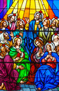 Stained glass in a catholic church colorful and beautiful different religious meanings and scenes of the christians traditions the Stock Photos