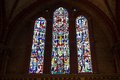 Stained glass church window in reddish tone Royalty Free Stock Photo