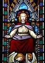 Stained glass image of jesus and angels window in english church showing Royalty Free Stock Images