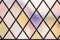 Stained glass with multi colored diamond pattern as background
