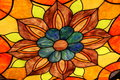 Stained glass orange flower Stock Photo