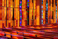 Stained glass pews Royalty Free Stock Image