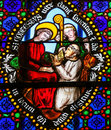 Stained Glass - Saint Conteste consecrated as bishop of Bayeux i Royalty Free Stock Photo