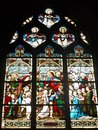 Stained glass surface is made up of multi colored artistically designed bonded with lead tape and serving for glazing of Stock Image