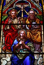 Stained glass: the Trinity and Maria Stock Image