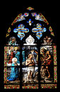 Stained glass window biblical scene on windows in church or cathedral Stock Image
