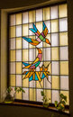 A stained glass window with bird design Royalty Free Stock Photo