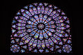 Stained glass window inside Notre Dame de Paris Royalty Free Stock Photo