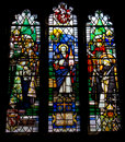 Stained glass window in a norman church in sussex england Royalty Free Stock Photos