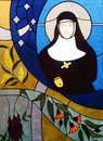 Stained glass window nun figure colourful religious themed with of a in a black habit Stock Images