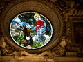 Stained glass window religious scene on a Royalty Free Stock Photos