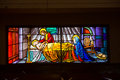 Stained glass window several hundred year old in a church tulip Royalty Free Stock Photo