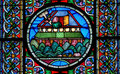 Stained glass window depicting Noahs Ark on the water