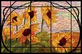 Stained glass window sunflowers in a frame. Autumn evening in the field. Warm pink and yellow color shades