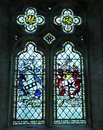 Stained glass windows the in a stone built church Royalty Free Stock Images