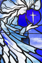 Stained leaded glass angels background vertical image of collage of a religious angel illustration and star of the east on blue Royalty Free Stock Photography