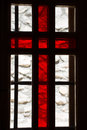 Stained window with red cross in a church Royalty Free Stock Photo