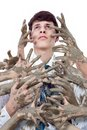 Stained young soul man looking up by multitude of dirty hands Stock Images
